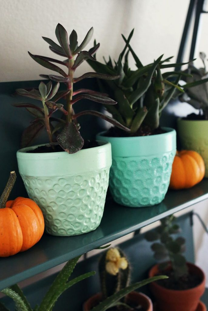 Here's a fun solution for creating cute planters that match the decor inside your home!