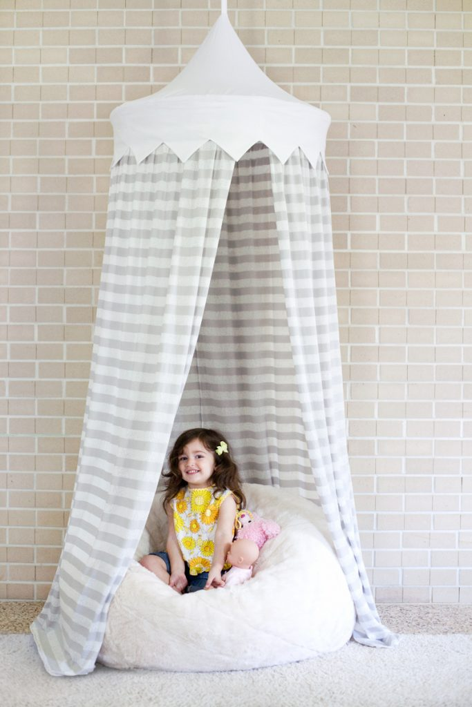 Tents, canopies, teepees and forts all make for special hideouts, and really only require some sheets and rope to put together. But if you'd like something more polished hanging in your home, this canopy-style tent might be just the thing!