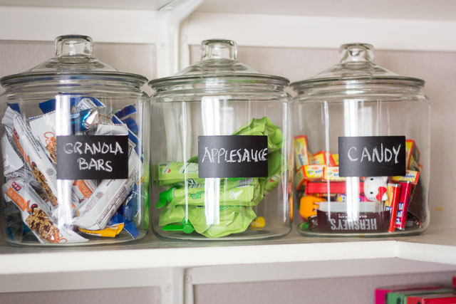 Use a mix of glass jars, plastic containers with pourable lids, baskets, and small risers/shelves for a super organized pantry!