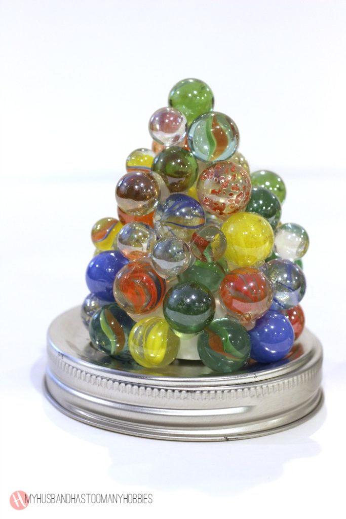 What to do with a hefty stash of marbles?  Why, make them lighted marble towers!