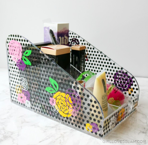 Cover a clear acrylic makeup case with vinyl to turn it into a floral and polka dot makeup holder.  Makes a great organizer for yourself or as a gift!