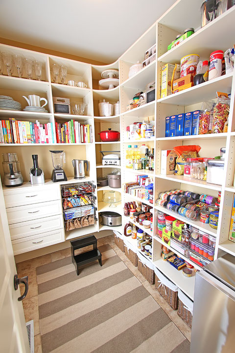 There are no words to explain the amount of love in this pantry.  Everything that's easy to see and grab and so neat and tidy!  You never know what room you might have in your house that could have a different use!