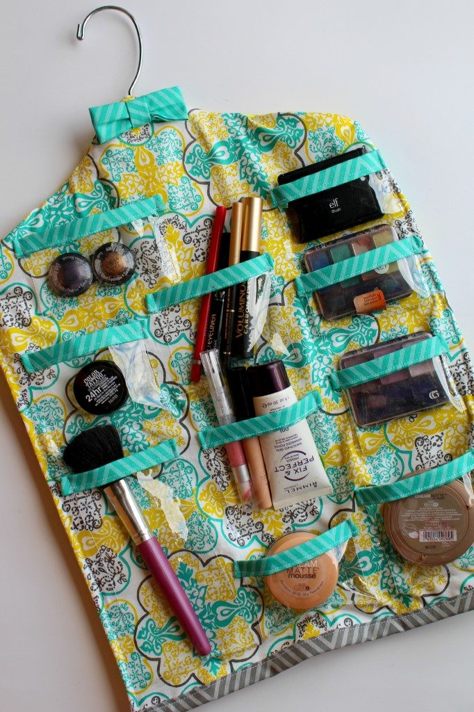 Use a plastic hanger and some coordinating fabrics for this darling hanging organizer!