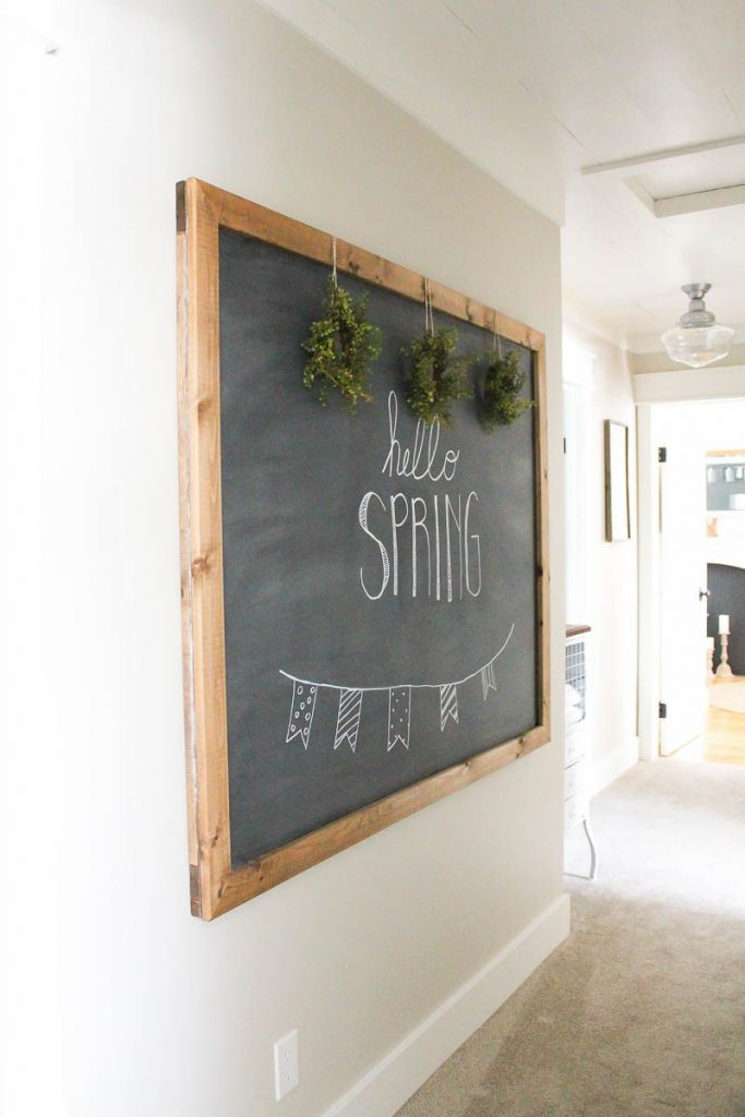 This large DIY chalkboard is so simple to make and, unlike most others out there, actually hangs on the wall like a piece of art.