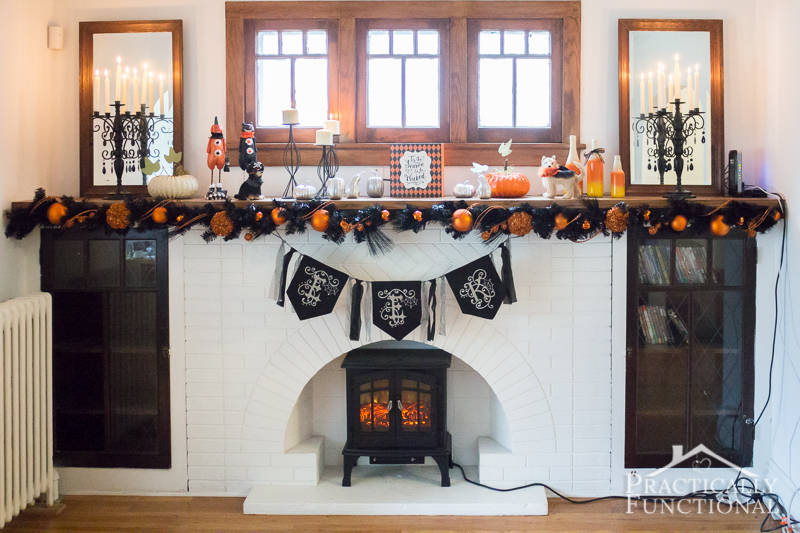 With some candelabras and taper candles, this fun festive mantel has a spooky touch.