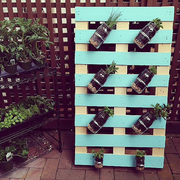With this Pallet herb garden you can customize the color and choose the various jars to mount.  Perfect for any small backyard or porch!