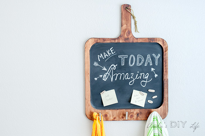Make an easy DIY magnetic chalkboard for the kitchen with basic tools. This multifunctional board is perfect to write inspirational quotes, add reminders and also for meal planning! Plus it holds your kitchen towel and apron or keys!