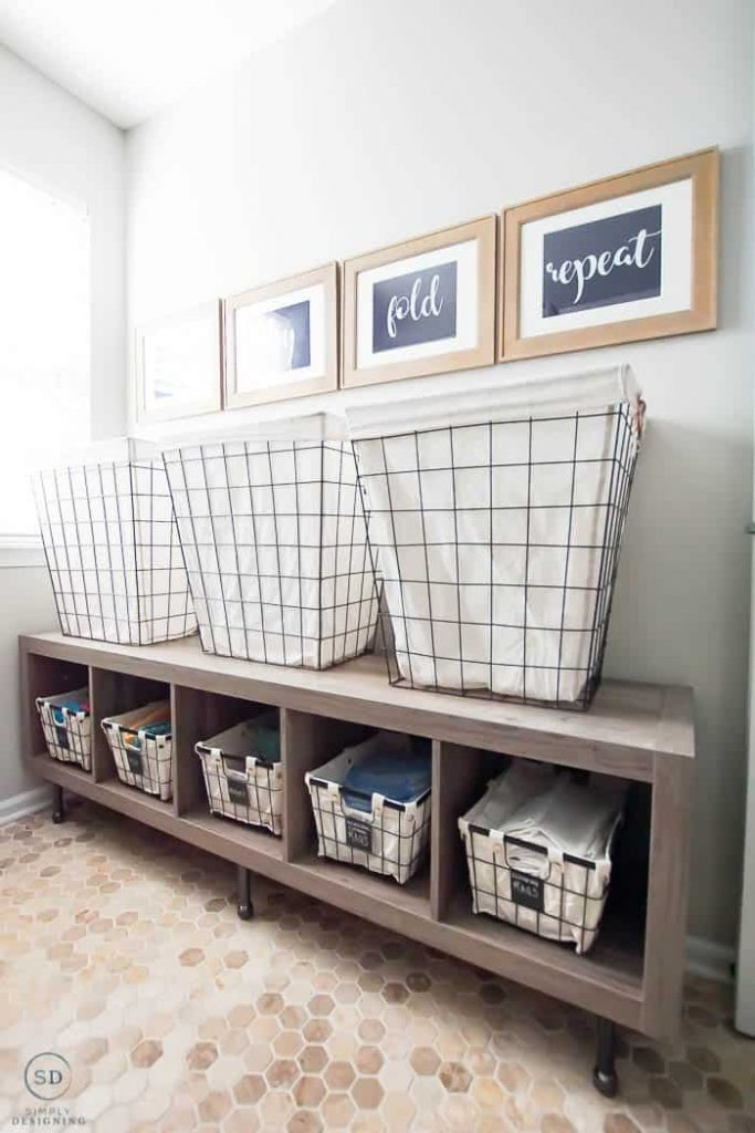 Add a storage cube for additional storage AND a raised place to put laundry baskets.  Functional and pretty.
