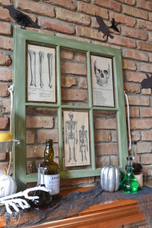 Mixing Apothecary Jars and an old window turned photo frame makes this mantel extra spooky!