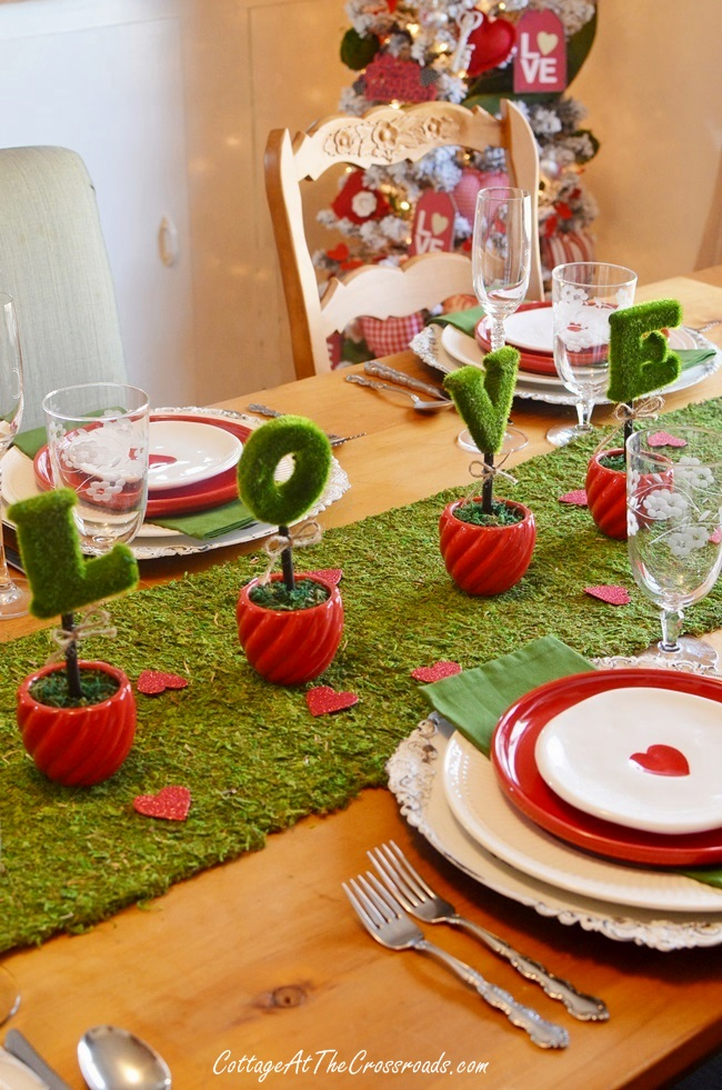 These tiny clay pots make a great, low profile centerpiece for a Valentine's Day tablescape.