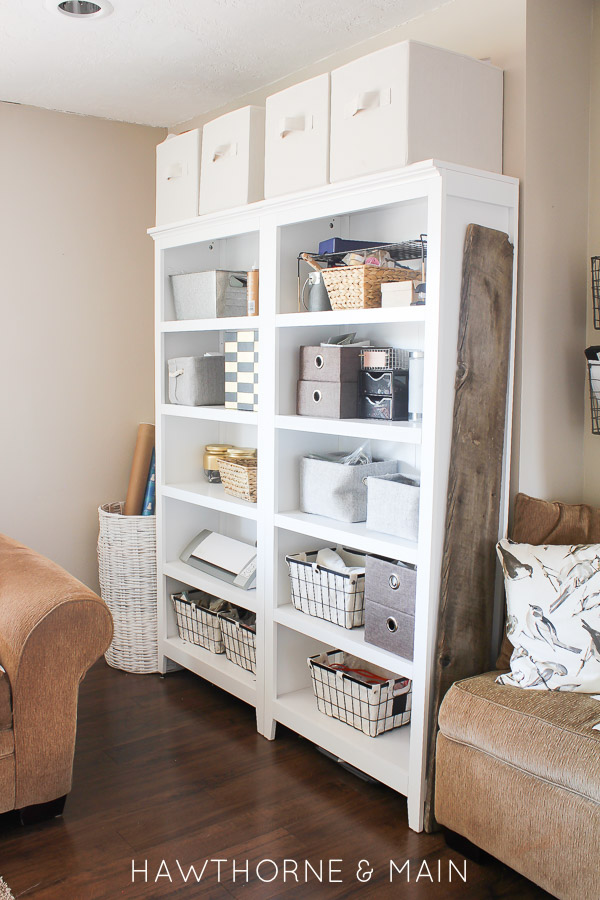 Don't have an empty room for your craft supplies?  You can actually have them in the living room when you organize them on pretty white shelves!