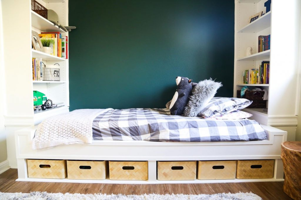 This easy built-in bed and DIY built-in shelves provide tons of storage and look gorgeous to boot.
