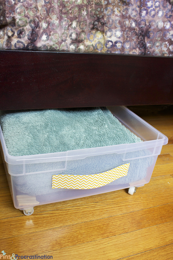 Even if you use plastic storage bins, you want to be able to get them out from under your bed easily. So why not turn them into drawers