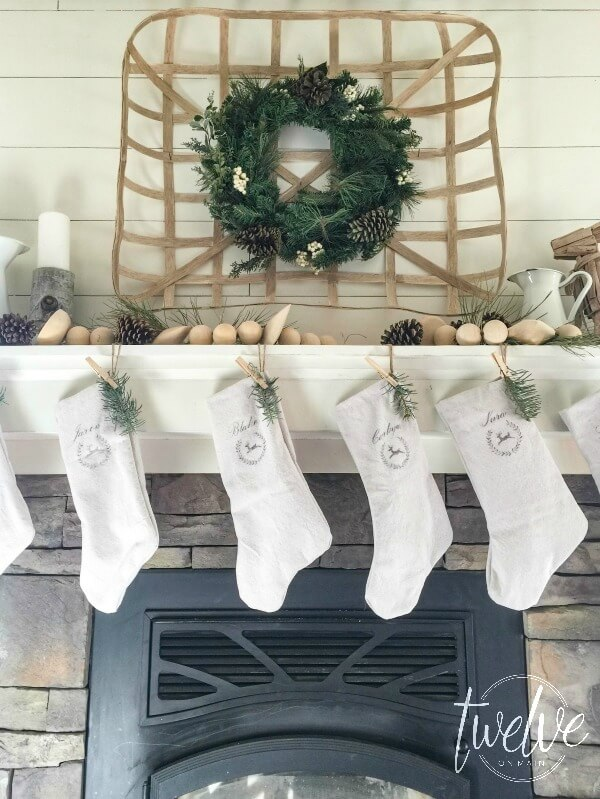 With this DIY basket, the natural look of the wood from the basket against the white shiplap and soft tomes of the wooden bead garland make the perfect mantel!