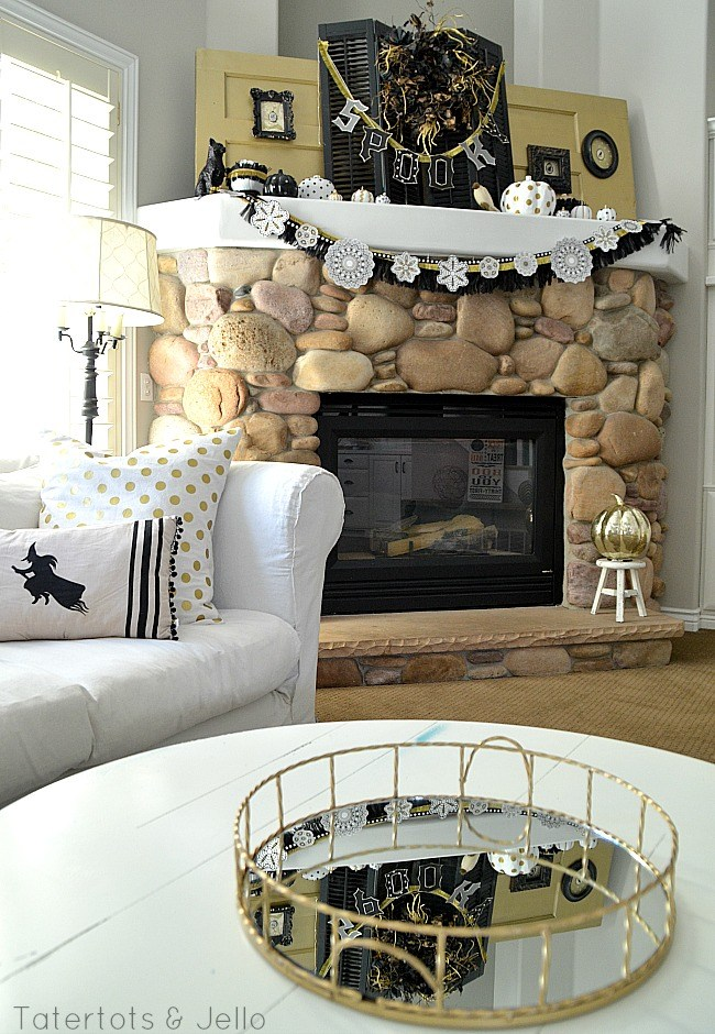 Who says a mantel must be all spooky?  The use of the old shutters on this mantel is genius!