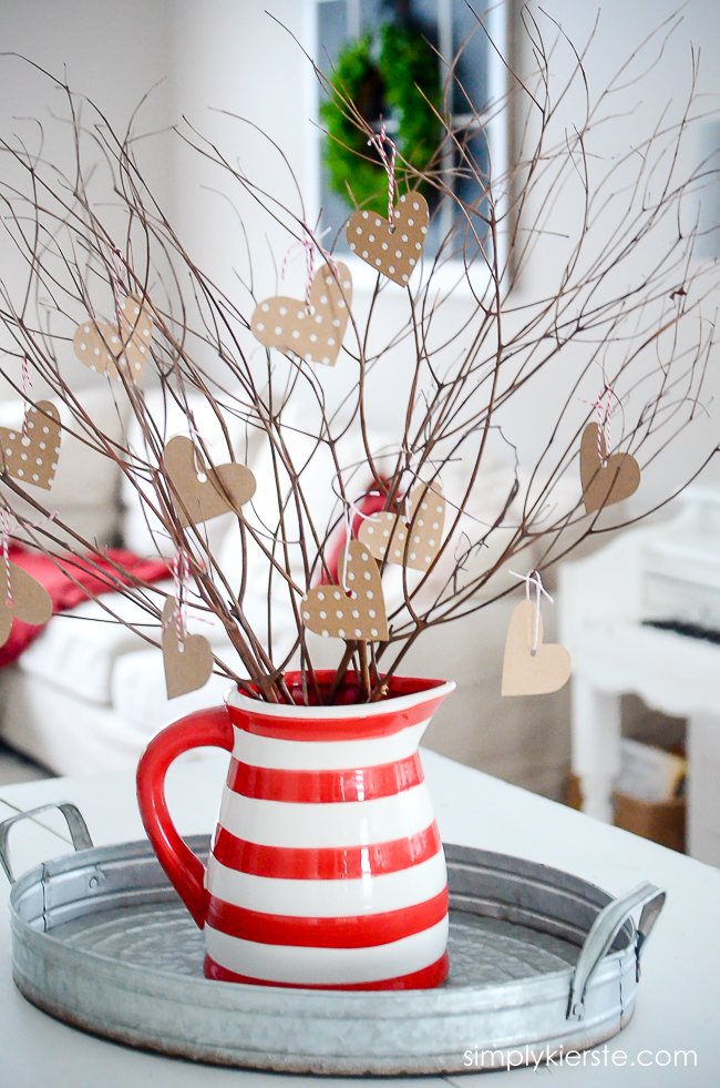 You can use the hearts on your tree as decor, or leave an extra pile of hearts around the pitcher (with the twine already on it) for the people in your family to write little notes to each other and hang on the tree.
