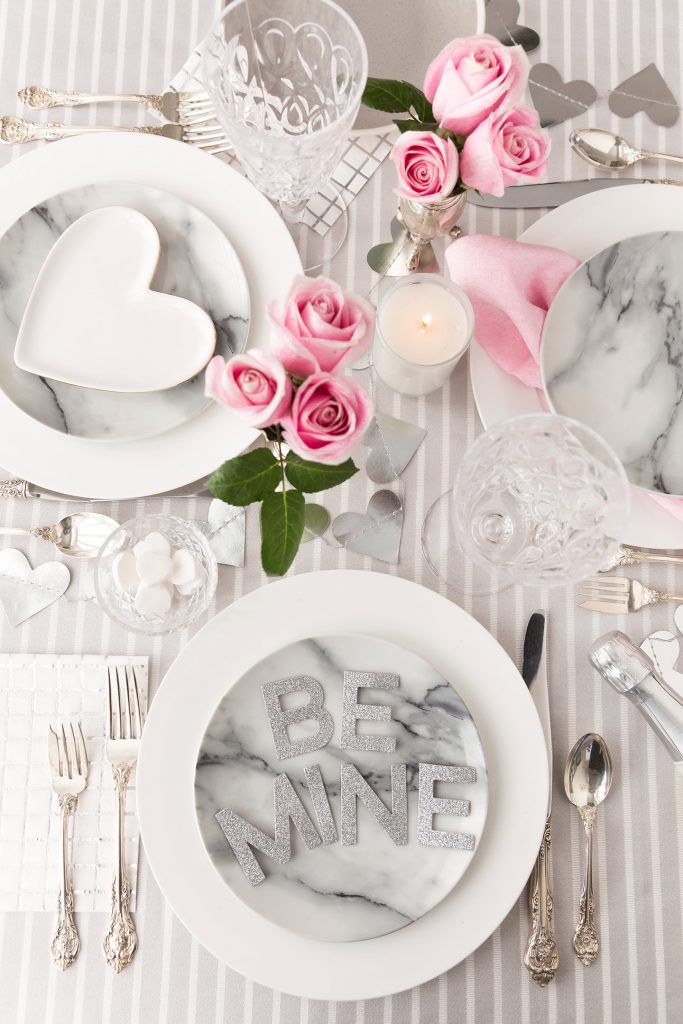 This tablescape is perfect for a romantic dinner as it would be for gathering of friends.  Add a few flowers and some heart garland, and your centerpiece is complete!