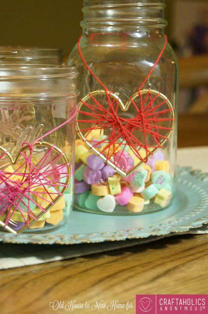 This Easy DIY Valentines Day Centerpiece is cute, easy, and even better, your kiddos can snack on the candy inside! It's decor and a treat jar in one!
