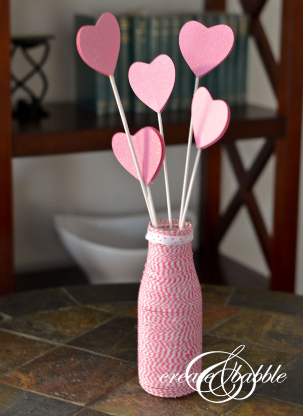 This easy-to-make Valentine's Day Centerpiece is made with a Starbucks Frappuccino bottle and so simple.