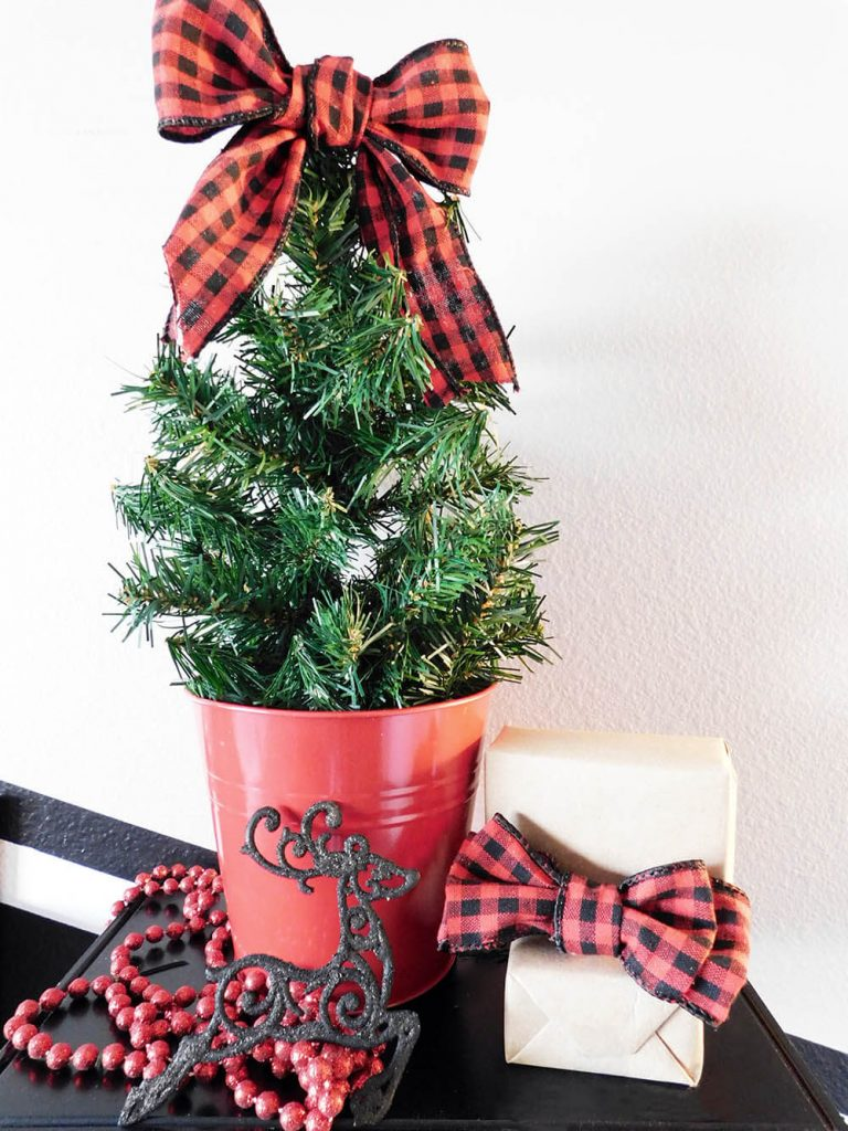 Easily DIY some faux Christmas Trees to group together on your Christmas Mantel!