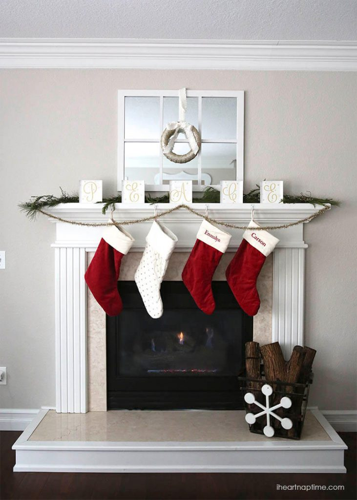The classic colors of red and white will never go out of style for any Christmas Mantel.