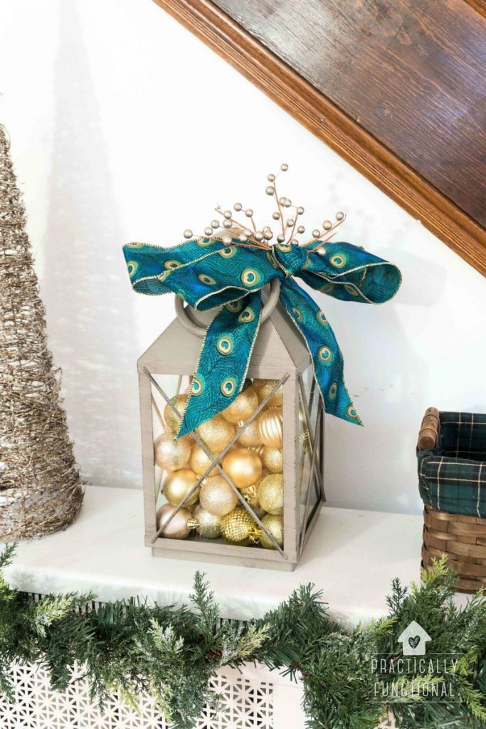 A simple lantern turns into the perfect Mantel decor when you pair it with Christmas ornaments.