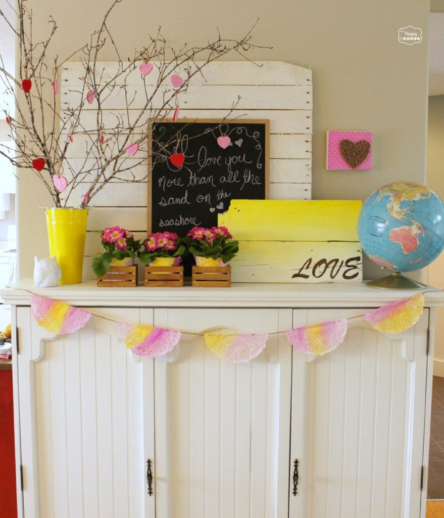 When you want to add some cheery colors into your mantel, this LOVE pallet sign and some Primulas set the stage for this design.