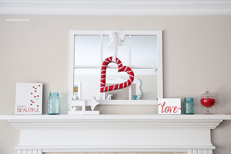 It's easy to have a clean, simple and glitter-less mantel and the red and turquoise combo is perfect!