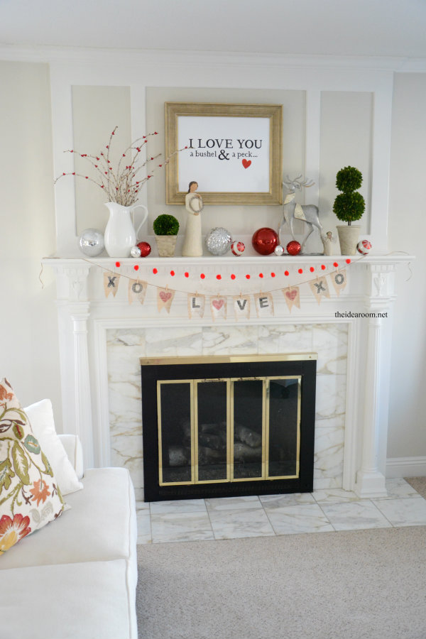 Using a large sign as the focal point of a mantel makes for the perfect addition to this mantel.